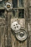 Old hubcaps in a dirty window royalty free stock photography
