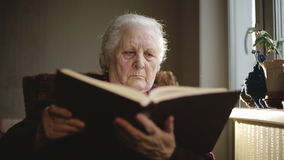 Old human reading a book. stock video