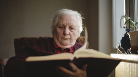 Old human reading a book. stock video footage
