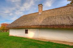 Old hungarian house. A reed-covered roof of a residential building as typical as in Hungary Royalty Free Stock Photo