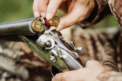 Old hunter loading his gun Royalty Free Stock Images