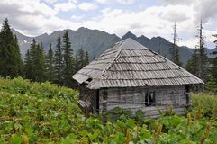 Old  hunters hut in the Carpathians mountains Royalty Free Stock Photo