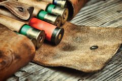 Old hunting cartridges and bandoleer Royalty Free Stock Images