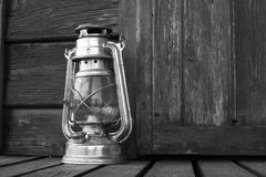 Old hurricane lamp. Old black and white hurricane lamp Royalty Free Stock Photo