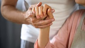 Old husband holding wife hand, spouse care and support, love connection, couple. Stock photo stock images