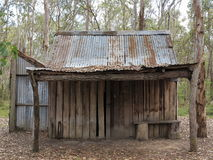 Simple cabin desolate. A simple cabin in the forest - a remainder of the Australian colonization era Royalty Free Stock Photos