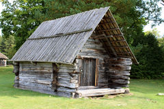 Old hut. Old log cabin with wooden roof royalty free stock image