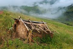 Old hut and mountain Stock Photo