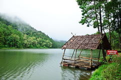 Old hut on the river with cloudy day Royalty Free Stock Image