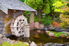 Old Hut with Waterwheel Royalty Free Stock Photos