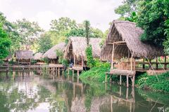 Old huts and piles of straw and wood where they dwelled fishermen Stock Photography