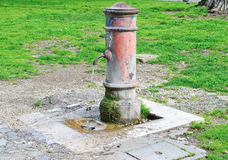 Old hydrant with flowing water Stock Photo