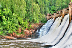 Old hydro power. Hole Porogi (Rapids) - operating hydro power built in 1909-1910, Satka district, Chelyabinsk region, Russia Royalty Free Stock Photo