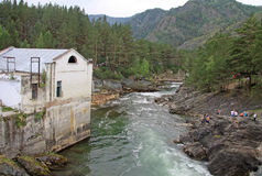 The old hydroelectric power station on the river Chemal in Altai mountains in Russia Stock Photos