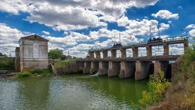 Old hydroelectric station. The flow of water. Ukraine. Old hydroelectric station. The flow of water. Ukraine Stock Image