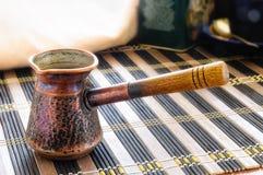 Old Ibrik - Turkish Coffee Pot. An old Ibrik. The Ibrik is a turkish coffee pot in copper, with a wooden handle stock photos