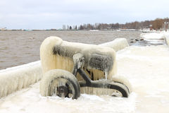 Old ice-covered cannon on a winter embankment Royalty Free Stock Images