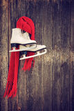 Old ice skates hanging on rustic wooden wall Stock Photography