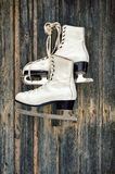 Old ice skates on wall Royalty Free Stock Images