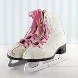 Old ice skates on white and blue vintage background Stock Photos
