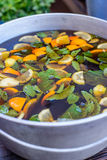 Ð¡old ice tea from an orange in a large casserole. Ice tea from orange slices and mint leaves in a large casserole stock photo