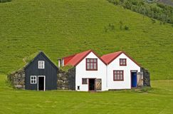 Old Icelandic houses. Exterior of old farming houses and barn with green hillside background, Skogar museum, Iceland royalty free stock photography