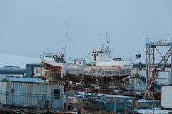Old Icelandic oak boat Huni in Akureyri ship yard. Akureyri Iceland - December 22 2017: Old Icelandic oak boat Huni in Akureyri ship yard Royalty Free Stock Photos