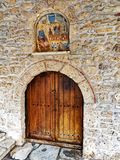 Panagia Dovra, Greek Orthodox Church,. Old icon and arched wooden door in stone wall, Greek Orthodox Church at Panagia Dovra, Veria, Macdonia, Northern Greece Royalty Free Stock Images
