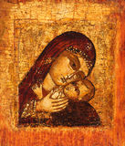 Old icon of Mother of God. Antique Russian orthodox icon of Mother of God (Mary) and child (Jesus Christ) painted on wooden board Royalty Free Stock Photo