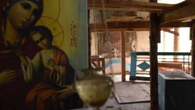 Old icon of the mother of God inside the temple stock video
