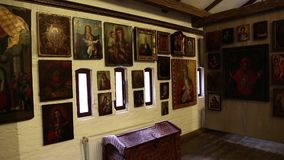 Old icons inside Radomysl Castle, the museum of Ukrainian home icons stock video