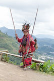 Old ifugao man in national dress next to rice terraces. Ifugao - the people in the Philippines. Stock Photo
