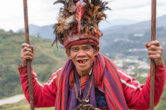 Old ifugao man in national dress next to rice terraces. Philippines Royalty Free Stock Photos