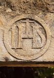 Old IHS symbol Royalty Free Stock Image