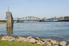 Old IJssel railway bridge and adjacent road bridge Stock Photo