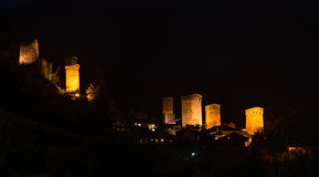 Old illuminated towers - Mestia. Tradition svanetian towers illuminated in night. Mestia (Svaneti), Georgia Stock Photos