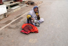 Old Indian beggar waits for alms on a street in Pushkar, India Stock Image