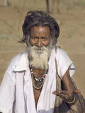 Old indian beggar waits for alms on a street. Pushkar, India Stock Photo