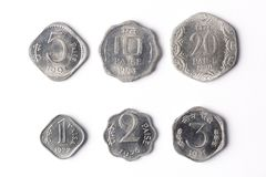 Old Indian coins. On a white bacground - Paise Royalty Free Stock Photography