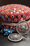 Old indian jewelery box with the earrings. Stock Image
