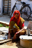Old Indian Lady with Cooking Implements, Mandawa, India Royalty Free Stock Image