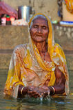 Old Indian Lady Portrait. Old Lady Praying in the Ganges River, Varanas in Incrediable Inida Stock Images