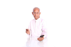 An old man using internet banking Stock Photography