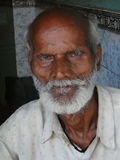 Old Indian man poses for his portrait Stock Image