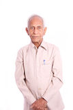 Portrait of senior citizen. An Old Indian Man smiling ,  against white background Stock Images