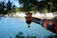 Old indian pipe. And view of the sea Royalty Free Stock Photo
