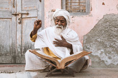 Old indian sadhu reading scriptures. Stock Images