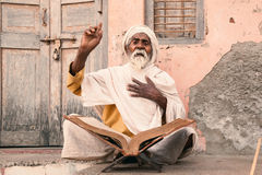 Old indian sadhu speak up sacred scriptures. Royalty Free Stock Photography