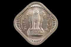 Old Indian square coin on a black background Royalty Free Stock Photos