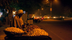 Old indian street vendor with wheel cart in evening Stock Image
